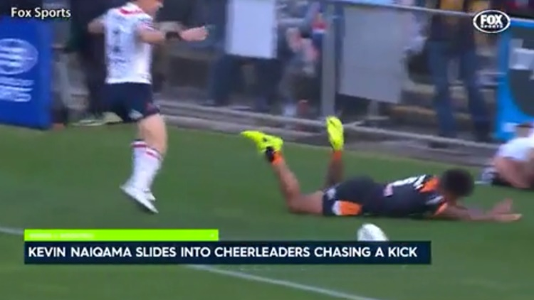 Moment Rugby Player Slides Into Squad Of Young Cheerleaders